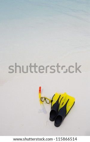 diver eyeglasses, diving goggles, snorkel and fins on the beach - stock photo