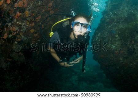 diver in swim through - stock photo