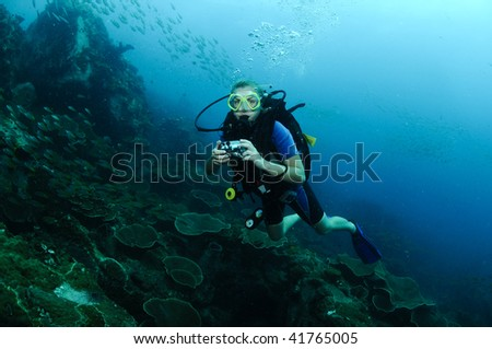 diver on coral reef - stock photo