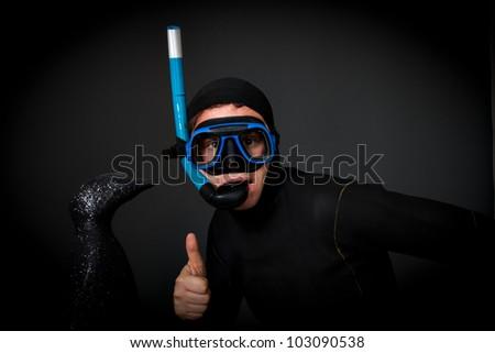 diver with penguin bizarre studio shot - stock photo