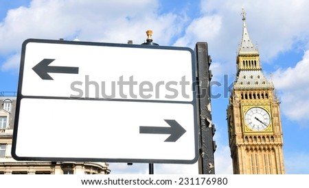 Divergent arrows customizable street sign in central London with Big Ben in the background - stock photo