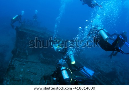 Divers and Marine shipwreck - stock photo