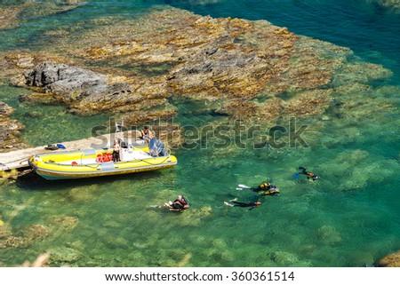 divers, Cap de Peyrefite, Languedoc-Roussillon, France - stock photo