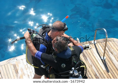 Divers checking there equipment before dive. - stock photo