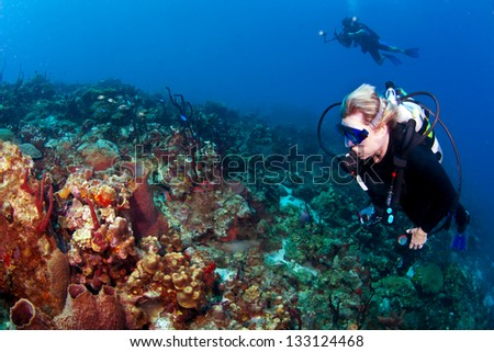 Divers on a reef on St Lucia with a Photographer - stock photo