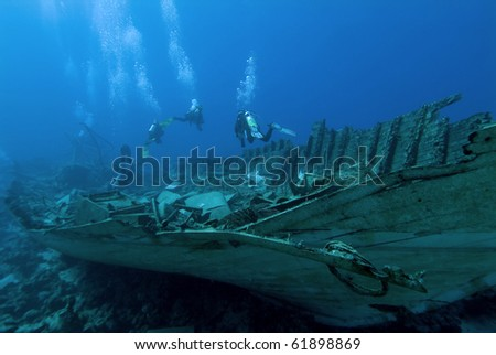 Divers on a wreck in the Red Sea - stock photo