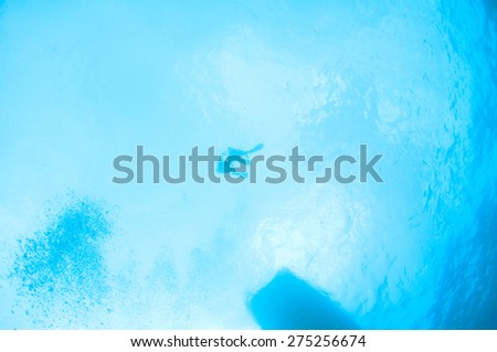 Divers on the surface. - stock photo