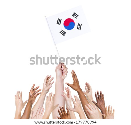Diverse and Multiethnic Hands Holding The Flag of South Korea - stock photo