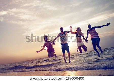 Diverse Beach Summer Friends Fun Jump Shot Concept - stock photo
