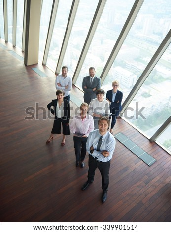 diverse business people group standing together as team  in modern bright office interior - stock photo