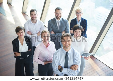 diverse business people group standing together as team  in modern bright office interior