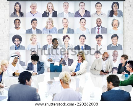 Diverse Business People in a Meeting with People's Portraits