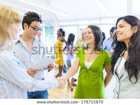 Diverse Business People Shaking Hands in Seminar - stock photo
