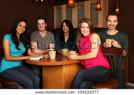 Diverse Group of Friends Bible Study in Cafe