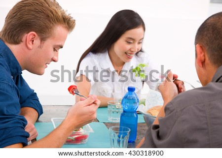 Diverse group of friends eating food - stock photo