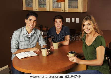 Diverse Group of Friends Reading the Bible - stock photo