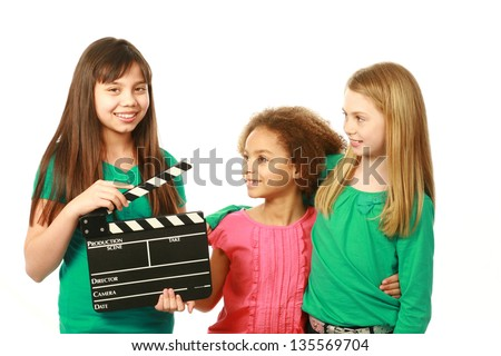 diverse group of girls with one holding film slate - stock photo