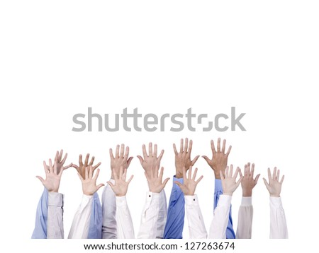 Diverse group of hands reaching into the air over a white background