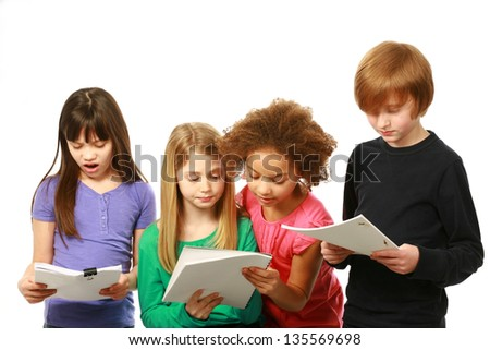 diverse group of kids reading scripts - stock photo