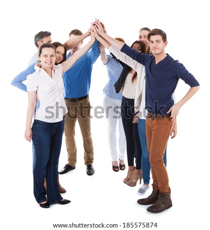 Diverse group of people making high five gesture. Isolated on white - stock photo