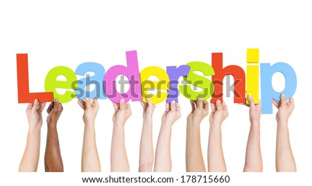 Diverse Hands Holding Colorful Leadership - stock photo