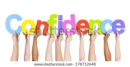 Diverse Hands Holding Confidence - stock photo