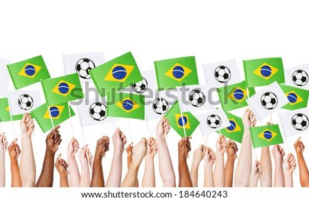 Diverse Hands Holding Flag of Brazil and Footballs
