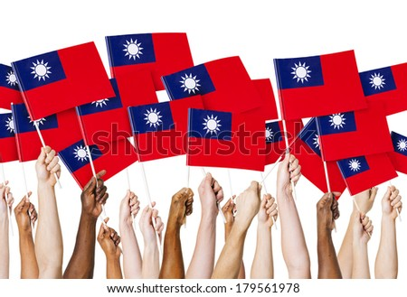 Diverse Hands Holding Flags of Taiwan