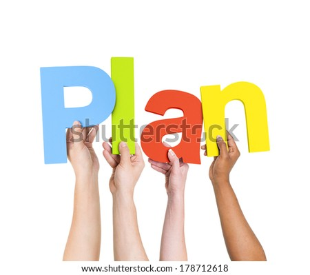 Diverse Hands Holding Plan - stock photo