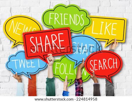 Diverse Hands Holding Speech Bubbles Social Media Concept - stock photo