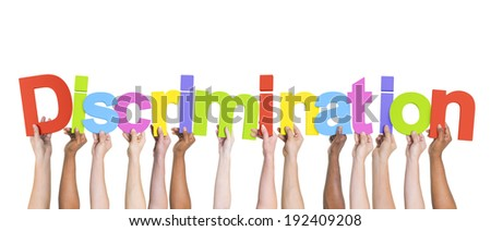 Diverse Hands Holding the Word Discrimination - stock photo