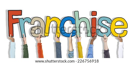 Diverse Hands Holding the Word Franchise - stock photo