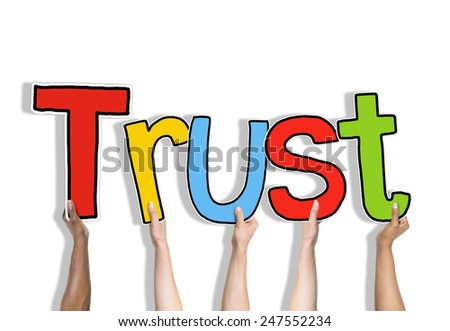 Diverse Hands Holding the Word Trust - stock photo