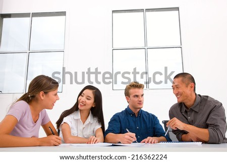 Diverse happy business people in meeting - stock photo