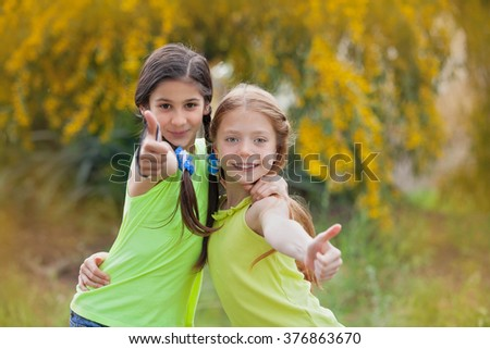 diverse happy smiling kids at summer camp thumbs up - stock photo