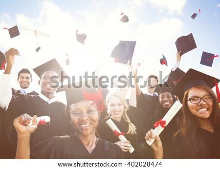 Diverse International Students Celebrating Graduation - stock photo
