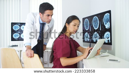 Diverse medical team working in the office together - stock photo