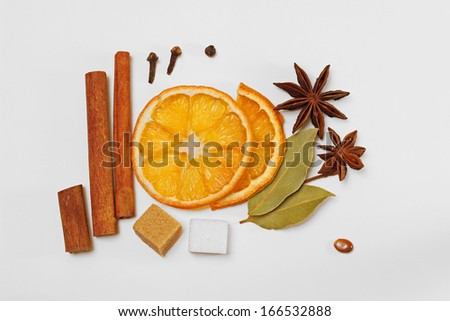 Diverse mulled wine / punch / tea condiments / spices and sugar cubes - stock photo
