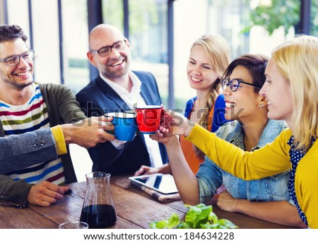 Diverse Multi-Ethnic Friends Cheering With Coffee - stock photo