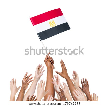 Diverse Multiethnic Hands Holding and Reaching For The Flag of England - stock photo