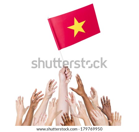 Diverse Multiethnic Hands Holding and Reaching For The Flag of Vietnam - stock photo