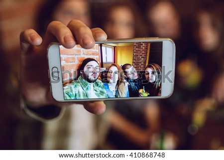 Diverse People Friends Hanging Out and taking selfie. Depth of field, selective focus