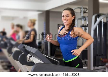 Diverse People Running on Treadmill - stock photo