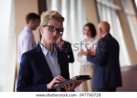 diverse startup business people group standing together as team  in modern bright office interior  with blonde  woman with glasses  in front as leader - stock photo
