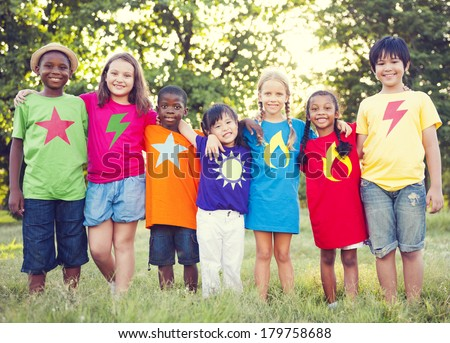 Diverse Superhero Children in The Park - stock photo