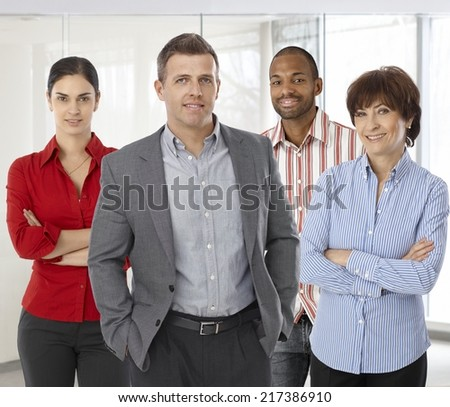 Diverse team of smiling office workers. Boss and employees of successful casual small business.