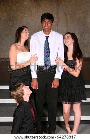 diverse teens in formal dress with girls flirting with boy