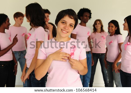 Diverse volunteer group with breast cancer awareness ribbon - stock photo