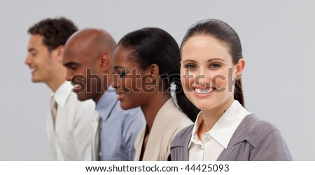 Diverse young business people sitting in a line in the office