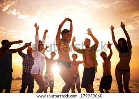 Diverse Young Happy People Dancing at Sunset - stock photo
